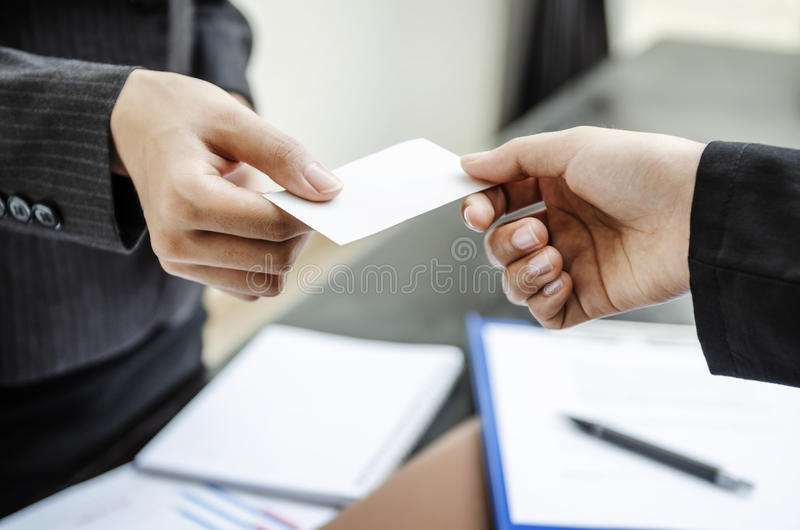 Giving business card stock images