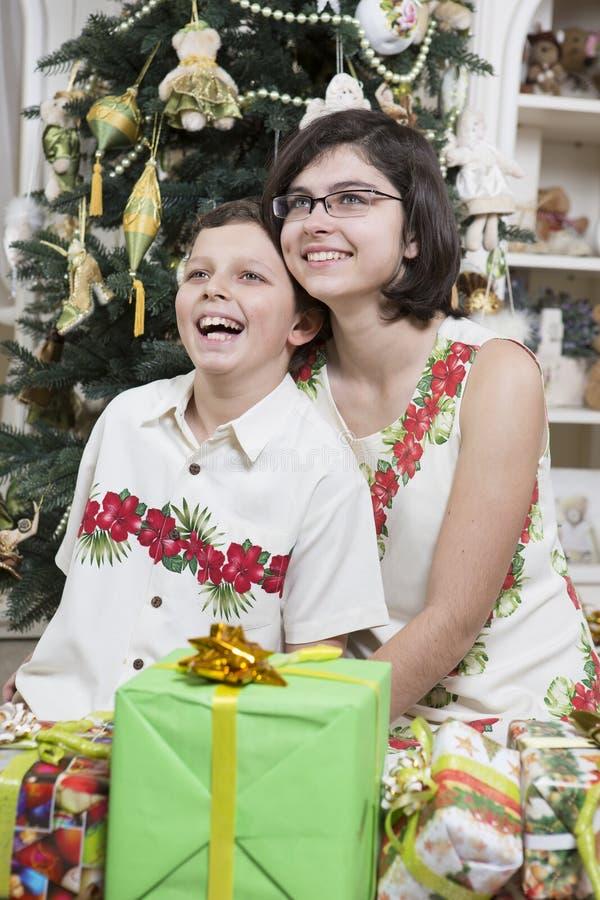 Giving Christmas Gifts Stock Photos