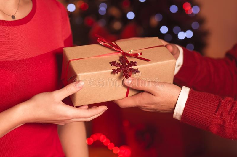 Giving Christmas present royalty free stock photography