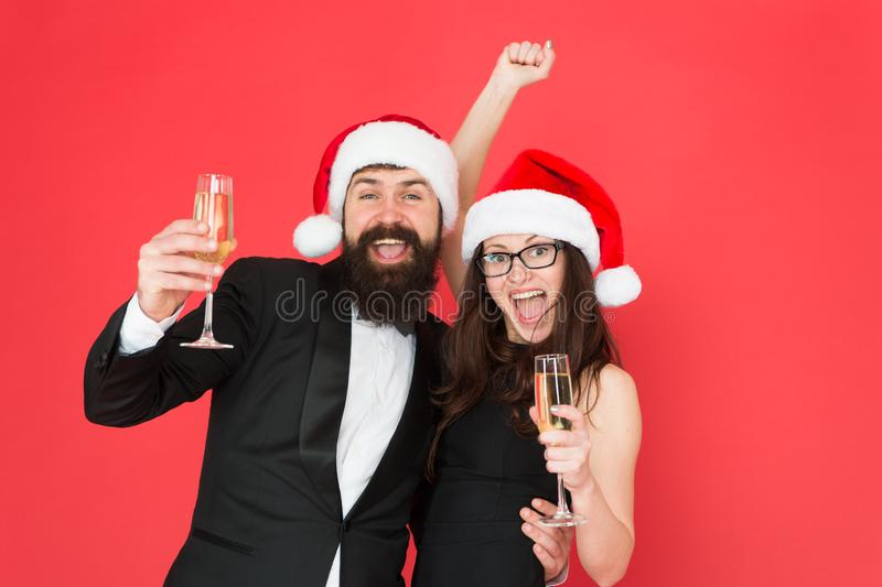 Giving Christmas toast. Happy family celebrate new year and Christmas. Couple in love with santa look party on Christmas. Eve. Merry christmas. Happy New Year royalty free stock photography