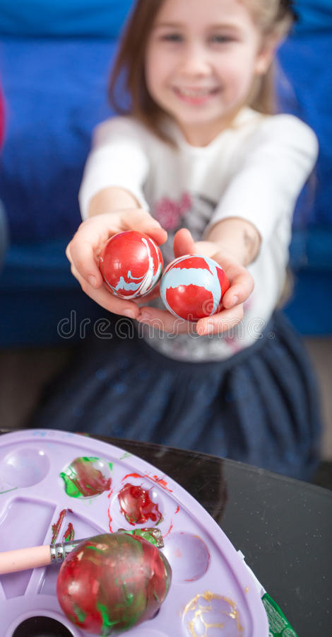 Giving colorful painting eggs, Happy Easter royalty free stock photos