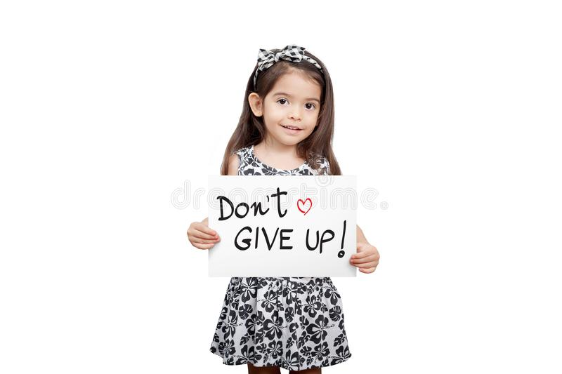Giving encouragement concept, Cute girl holding a don`t give up. Sign standing on white background. Cute mixed race girl half Thai, half English model 3 years stock photography
