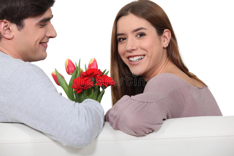 Giving flowers to his girlfriend stock image