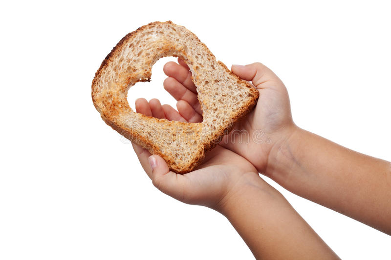 Giving food with love. Concept - slice of bread in child hands, isolated stock image