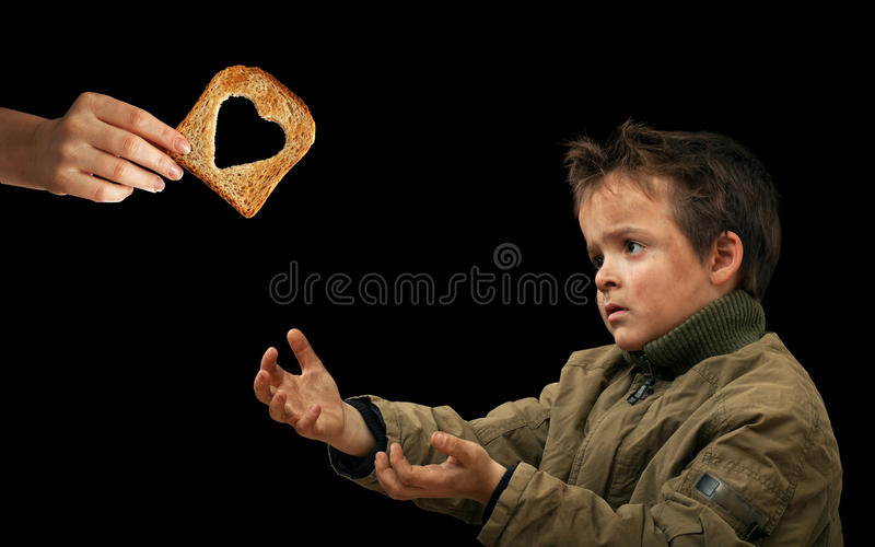 Giving food to the needy stock photos