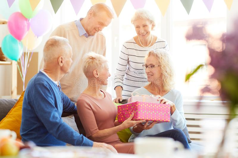 Giving gifts at home party royalty free stock photo