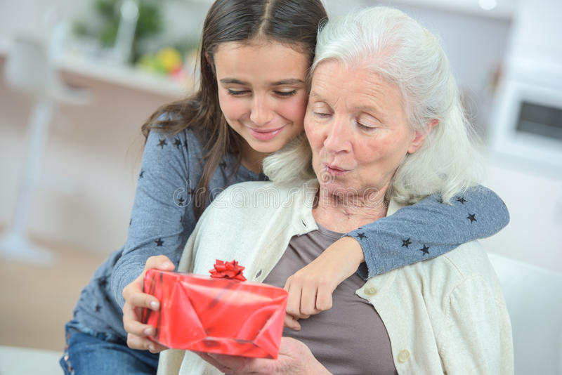 Giving grandma gift royalty free stock photo