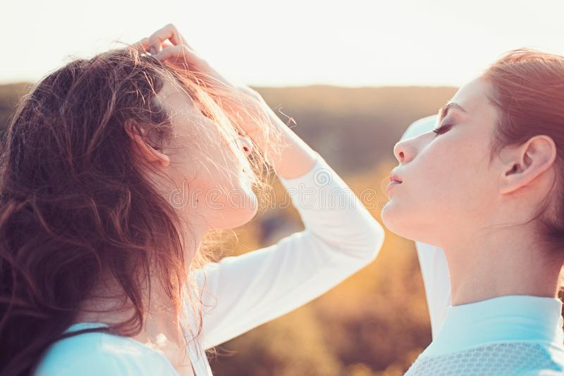 Giving hair its strength. Teenage girls with natural wavy hairstyle. Cute girls with long hairstyle. Young women with. Healthy hair. Hair care and hair styling royalty free stock photo