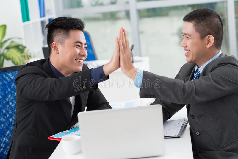 Giving high five royalty free stock photo