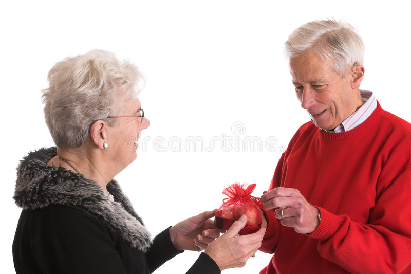 Giving Him A Box Of Chocolates Stock Image