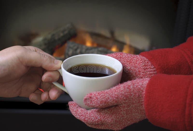 Giving a hot coffee royalty free stock photos
