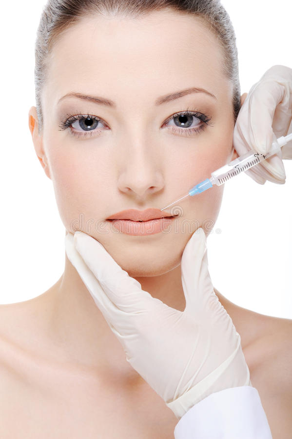 Giving injection of botox stock image