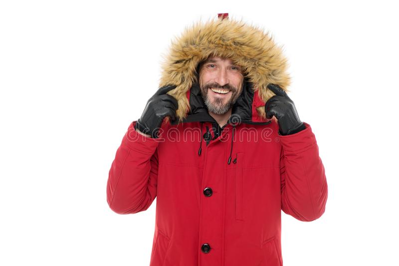 Giving the man a sense of style. Happy fashion model wear fur hood isolated on white. Mature man in winter style royalty free stock image