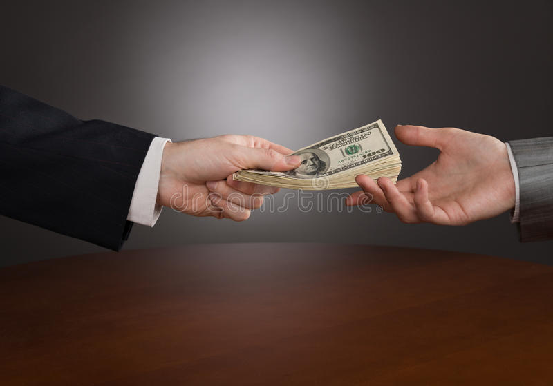 Giving money stock images