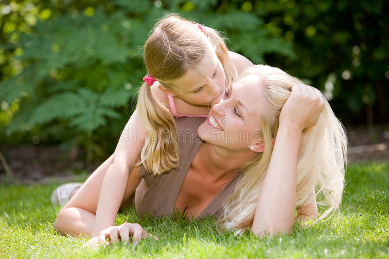 Download Giving mum a kiss stock image. Image of lying, daughter - 5322613