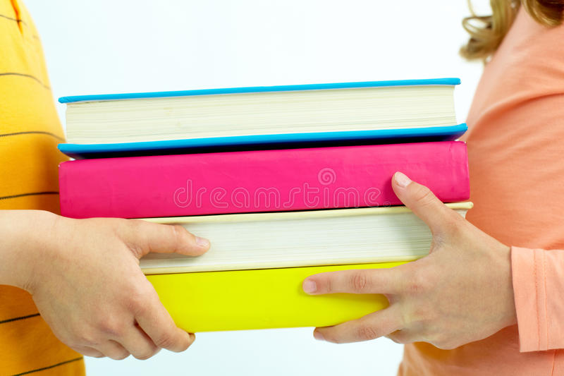 Giving Stack Of Books Royalty Free Stock Image