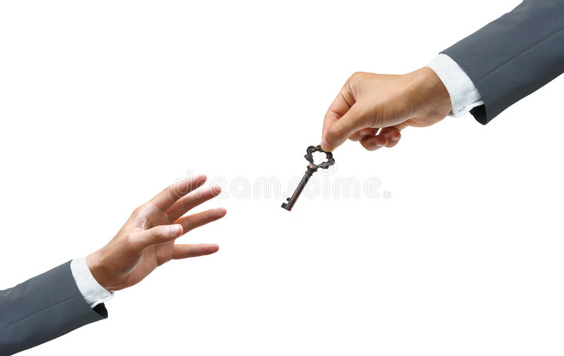 Giving success. Hand of a businessman giving a key to many hopeless hands - giving help, opportunity, success concept royalty free stock photography