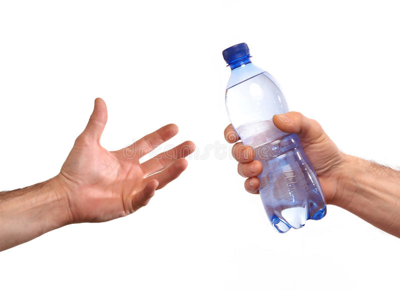 Giving water bottle. Giving a mineral water bottle stock photos