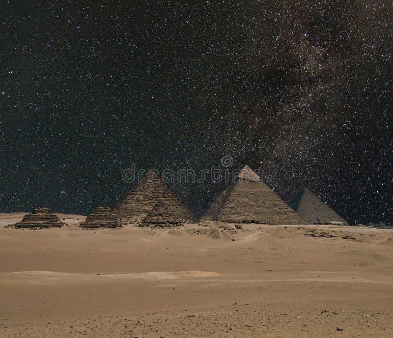 The Giza pyramid complex under night starry sky stock photos