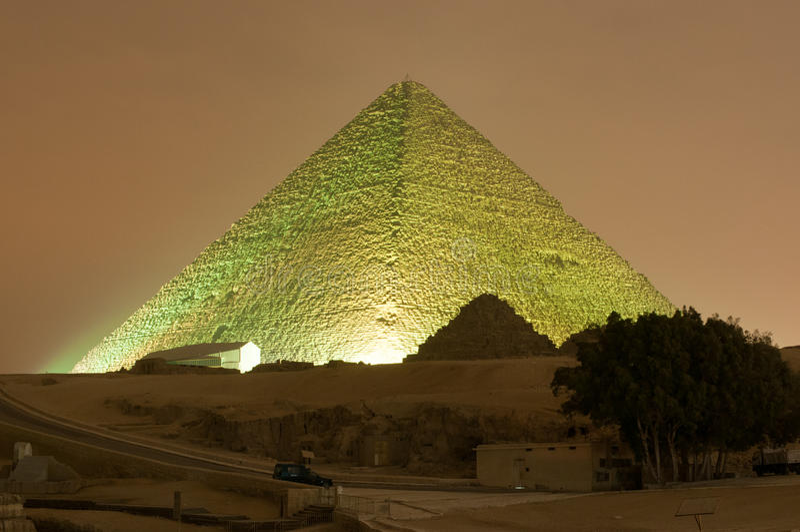 Giza Pyramid and Sphinx Light Show at Night - Cairo, Egypt. CAIRO, EGYPT - JANUARY 1, 2009: Giza pyramid and Sphinx light up for magical sound and light show royalty free stock photos