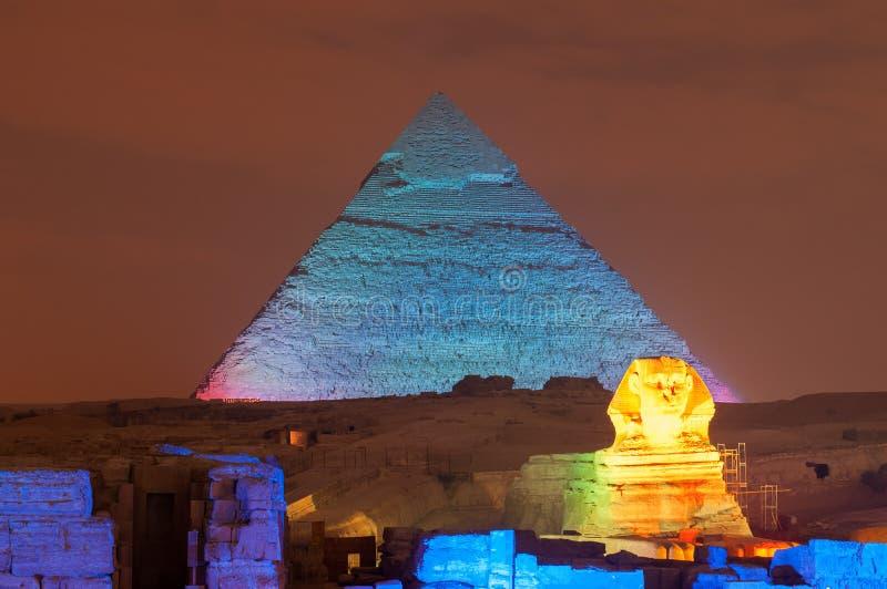 Giza Pyramid and Sphinx Light Show at Night - Cairo, Egypt. CAIRO, EGYPT - JANUARY 1, 2009: Giza pyramid and Sphinx light up for magical sound and light show royalty free stock photo