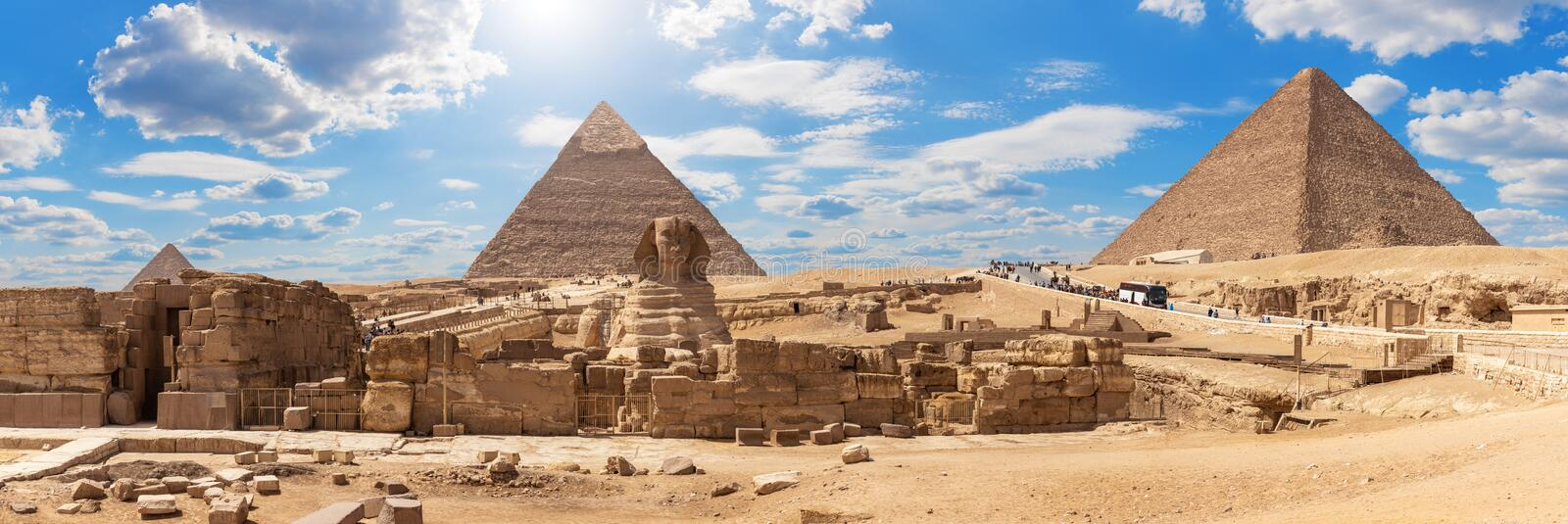 Giza Pyramids and the Sphinx, beautiful Egyptian panorama. Africa, ancient, archaeological, archeology, architecture, blue, building, cairo, camel, chephren royalty free stock photos