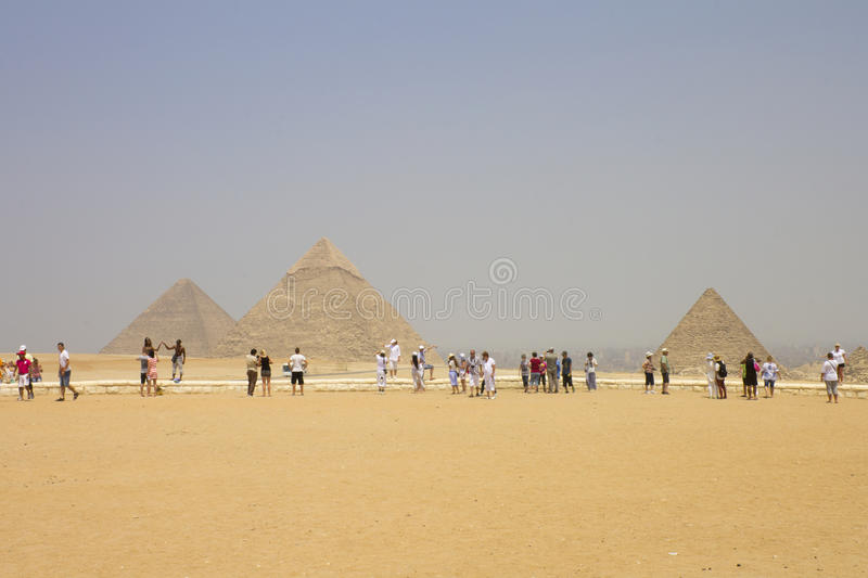 Download Giza - Pyramids With The Tourists Admiring Them Editorial Stock Photo - Image: 26347908