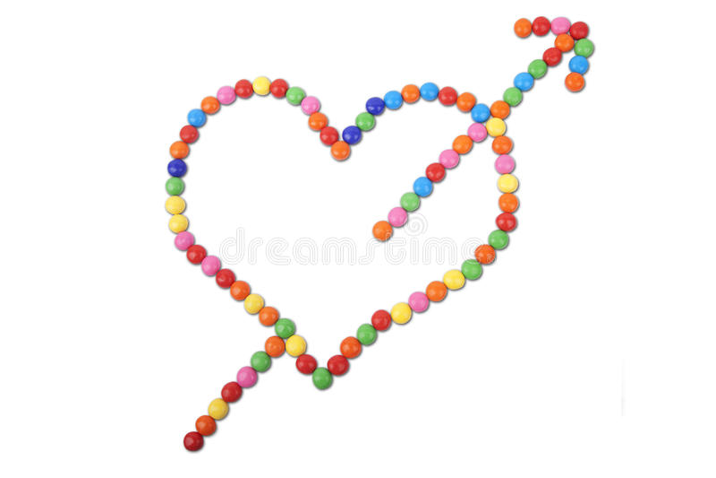 gjord färgrik hjärta för pilgodis arkivbild