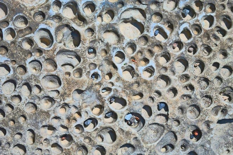 Gjort full av hål vagga textur - bakgrund arkivbild