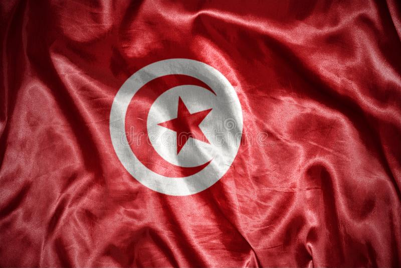 glänsande tunisian flagga arkivfoton