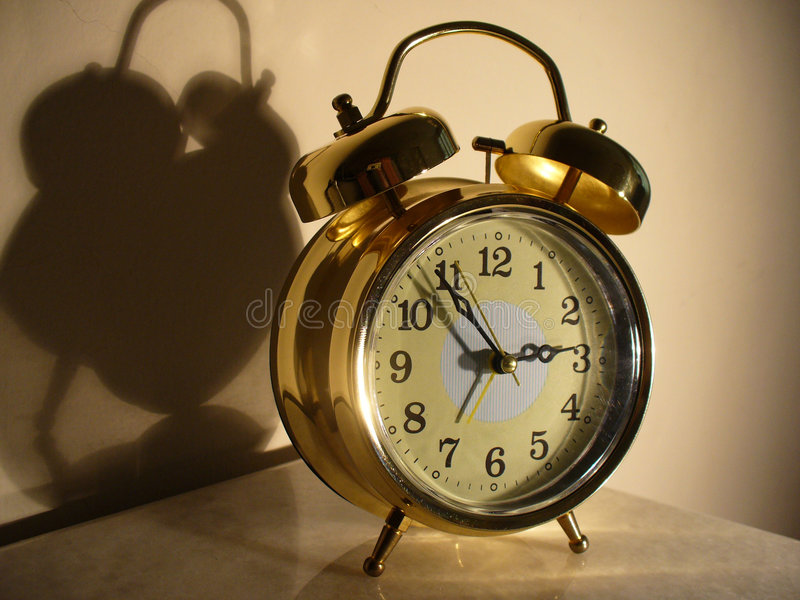 Glänzende Alarmuhr stockbilder