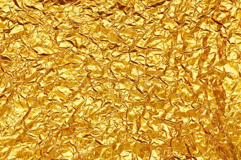 Glänzende gelbe Blattgoldfolie stockfoto
