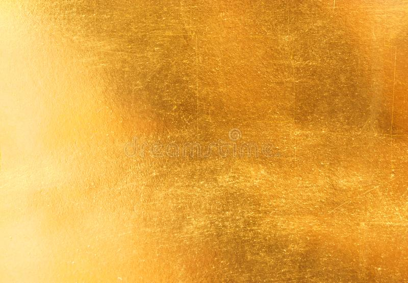 Glänzende gelbe Blattgoldfolienbeschaffenheit lizenzfreies stockfoto