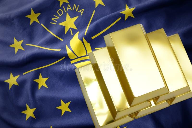 Glänzende goldene Goldbarren auf der Indiana-Staatsflagge lizenzfreie stockbilder