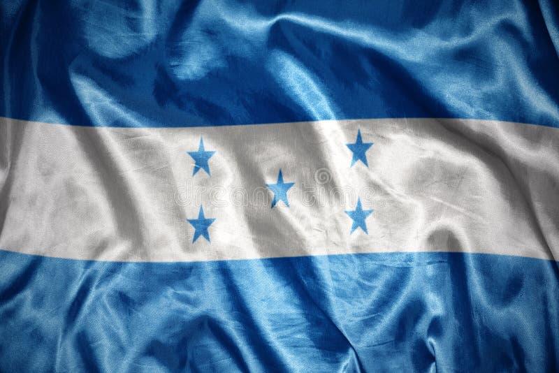 glänzende honduranische Flagge lizenzfreie stockbilder