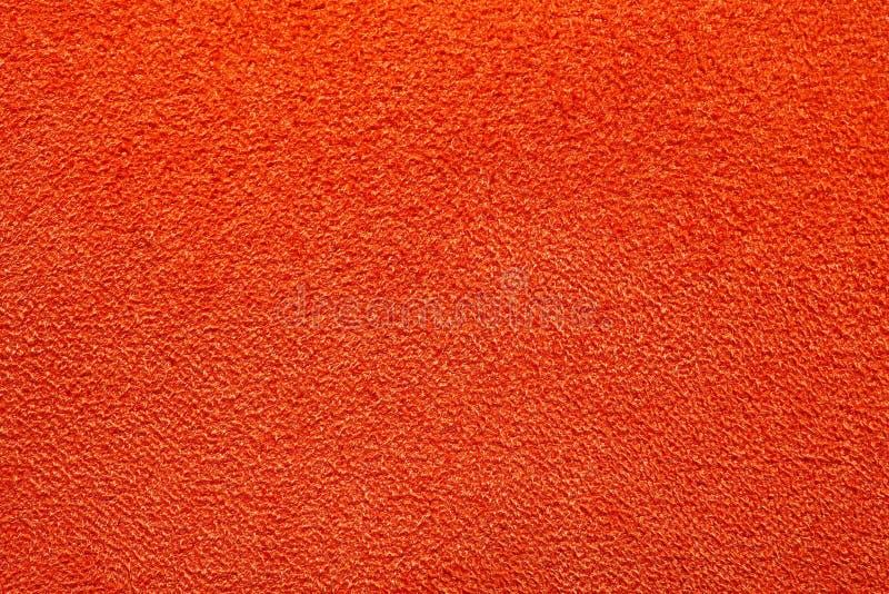 Glänzende warme orange Gewebebeschaffenheit lizenzfreies stockfoto