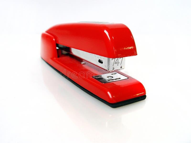 Glänzender roter Hefter lizenzfreie stockbilder