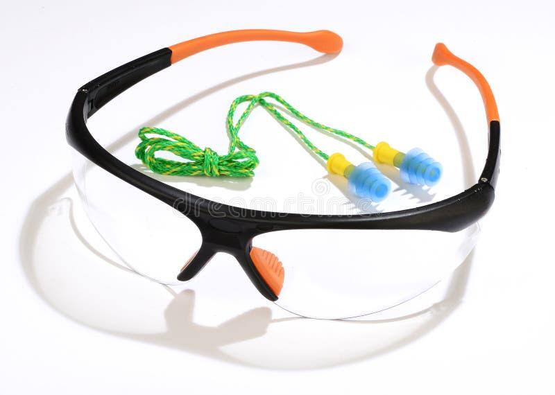 Gläser und Ohrenpfropfen stockbild