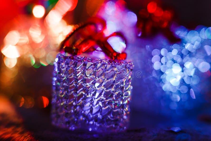 glödande exponeringsglaskub, julljus royaltyfri bild