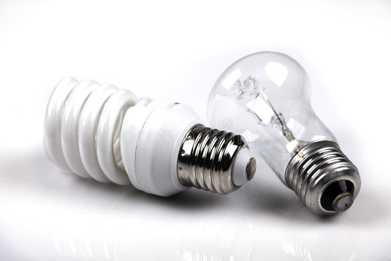 Glödande och energi - besparingvitbakgrund arkivfoton