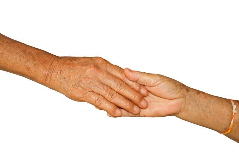 Glückliche ältere erwachsene Paare, die Hände zusammenhalten stockfotos