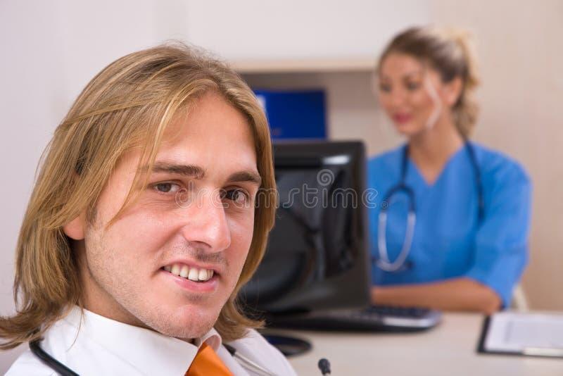 Glückliche Ärzte stockfotografie