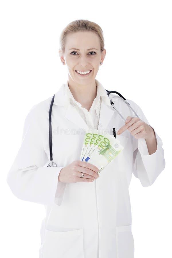 Glückliche Ärztin Holding Cash und Stethoskop lizenzfreies stockfoto
