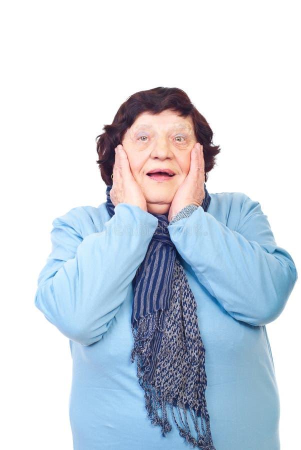 Glückliche überraschte ältere Frau lizenzfreie stockbilder