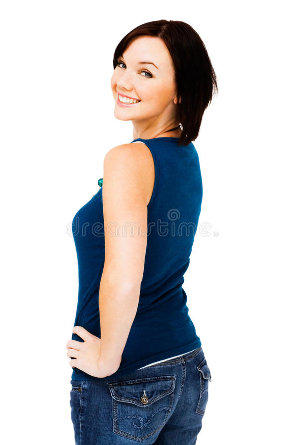Glückliche Aufstellung der jungen Frau stockfotografie