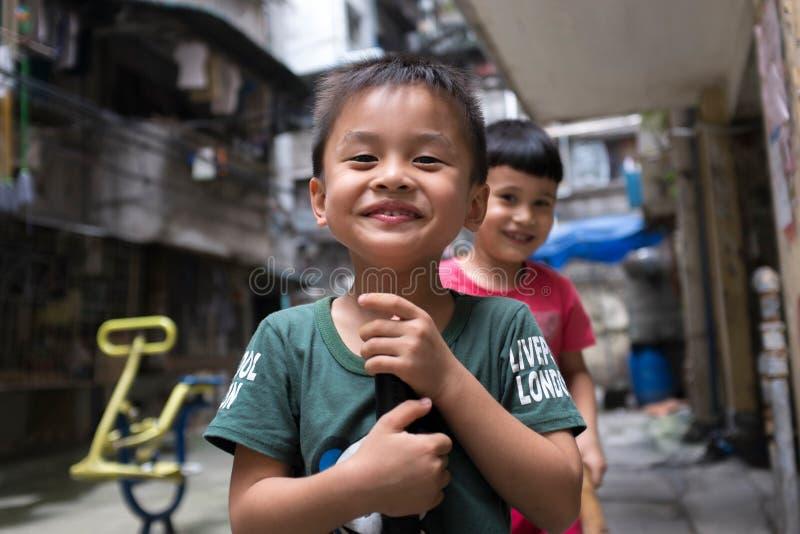 Glückliche chinesische Kinderjungen stockbilder