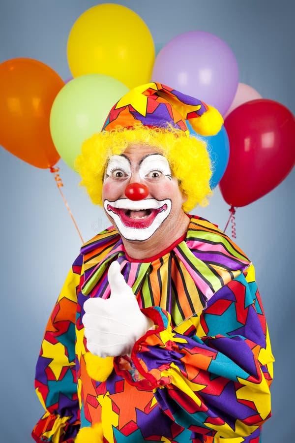 Glückliche Clown-Daumen oben stockfoto