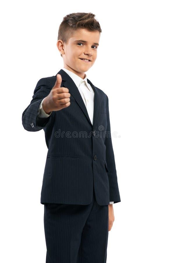 Glückliche darstellende Daumen des Schülers oben lizenzfreie stockfotografie