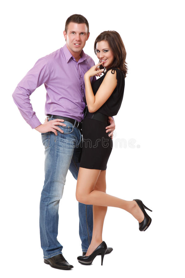 Glückliche elegante Paaraufstellung lizenzfreie stockfotografie