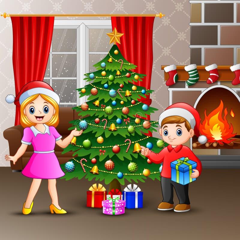 Glückliche Familie, die einen Weihnachtsbaum mit Bällen verziert stock abbildung